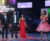 pictrure of the Star Academy 7 prime 16th finale while Hilda Khalife the show presenter on stage with three nominees Rahma and Nassif and Mohamed Ramadan
