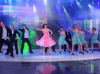 pictrure of the Star Academy 7 prime 16th finale while Hilda Khalife the show presenter on stage dancing with the dancers 5