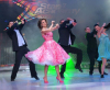pictrure of the Star Academy 7 prime 16th finale while Hilda Khalife the show presenter on stage dancing with the dancers 2