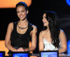 Jessica Alba and Vanessa Hudgens speak onstage at the 2010 MTV Movie Awards held at the Gibson Amphitheatre on June 6th 2010 at Universal Studios in California 5