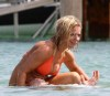 Geri Halliwell seen on June 19th 2010 wearing a stylish orange bikini suit while at the beach of St Tropez France 5