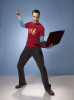 poster quality photo of actor Sheldon Cooper played by actor Jim Parsons in The Big Bang Theory comedy series with his laptop