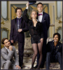 The Big Bang Theory poster of Sheldon, Leonard, Rajesh, Penny and  Wolowitz wearing formal black suits