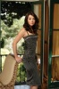 Alyson Hannigan photoshoot for  HOW I MET YOUR MOTHER TV comedy show in a maxi black patterned summer dress
