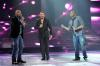 picture of Ramy Ayach as he performs on stage at the third prime of star academy with Mohd Daqdouq and Ephram Salameh on April 15th 2011