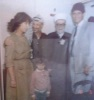 Family of the Palastinian student Lian Bazlamit photo of her father and mother with Yasser Arafat