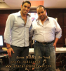 NEW photo of Karim Kamel as he signs the contract of kMusic production company 2