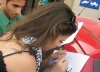 Layan Bazlamit picture on July 3rd 2011 as she arrives to Amman airport in Jordan signing an autograph for a fan