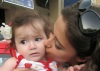 Layan Bazlamit picture on July 3rd 2011 as she arrives to Amman airport in Jordan with a cute little baby girl