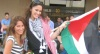 Layan Bazlamit picture on July 3rd 2011 as she arrives to Amman airport in Jordan with her older sister