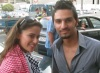 Layan Bazlamit picture on July 3rd 2011 as she arrives to Amman airport in Jordan with a fan