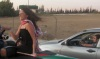 Layan Bazlamit picture on July 3rd 2011 as she arrives to Amman airport in Jordan at the top of a car
