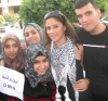 Layan Bazlamit picture on July 3rd 2011 as she arrives to Amman airport in Jordan with fans