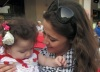 Layan Bazlamit picture on July 3rd 2011 as she arrives to Amman airport in Jordan with a baby fan