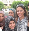 Layan Bazlamit picture on July 3rd 2011 as she arrives to Amman airport in Jordan with fans waiting for her at the airport entrance