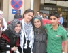 Layan Bazlamit picture on July 3rd 2011 as she arrives to Amman airport in Jordan with her fans waiting for her at the airport entrance