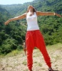 Newset photo of Nina Abdl Malak wearing red pants and a white top in June 2011 at a city in Lebanon after leaving star academy 9