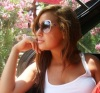 Newset photo of Nina Abdl Malak wearing red pants and a white top in June 2011 at a city in Lebanon after leaving star academy 4