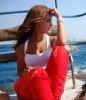 Newset photo of Nina Abdl Malak wearing red pants and a white top in June 2011 at a city in Lebanon after leaving star academy 8