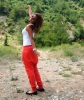 Newset photo of Nina Abdl Malak wearing red pants and a white top in June 2011 at a city in Lebanon after leaving star academy 12