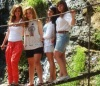 Newset photo of Nina Abdl Malak wearing red pants and a white top in June 2011 at a city in Lebanon after leaving star academy 13