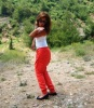 Newset photo of Nina Abdl Malak wearing red pants and a white top in June 2011 at a city in Lebanon after leaving star academy 11