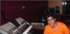 photo of the Kuwaiti student of star academy Abdul Salam after leaving star academy at the studio wearing an orange tshirt 3